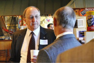 Ted Bachman, a business consultant, talks to economist Mike Walden after Walden's speech at Knightdale Seafood & BBQ on Jan. 4. PAUL A. SPECHT - ASPECHT@NEWSOBSERVER.COM Buy Photo